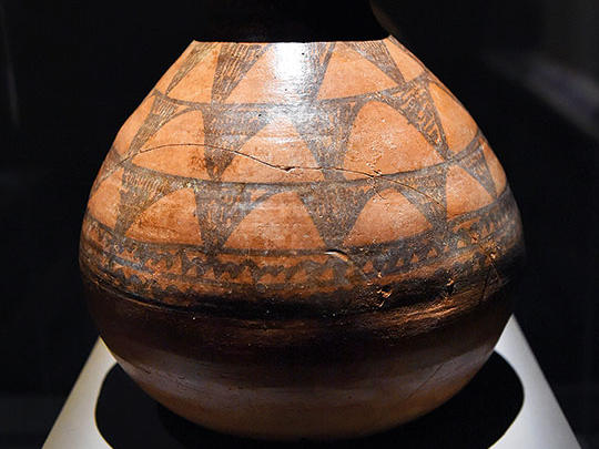 A globular jar with geometrical decoration.