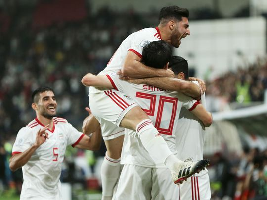 Iran's players celebrate