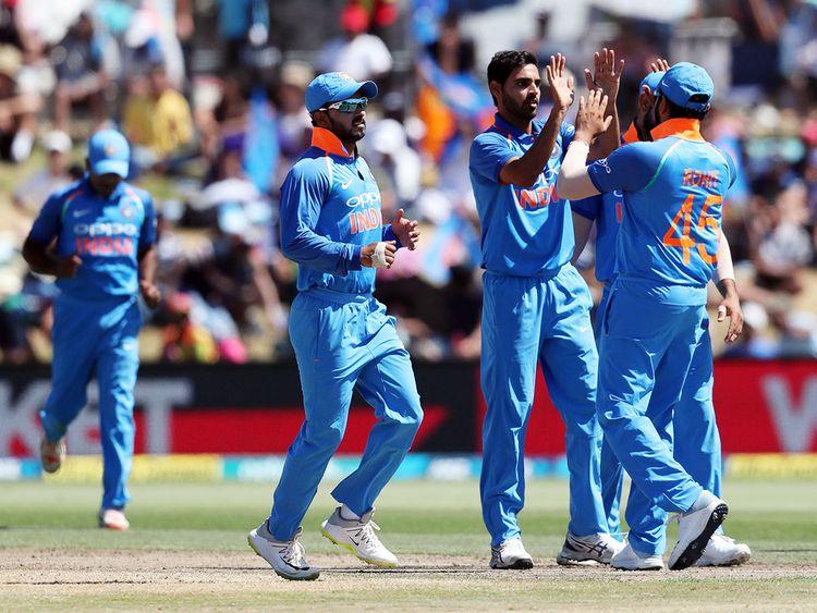 India's Bhuvneshwar Kumar (C) celebrates