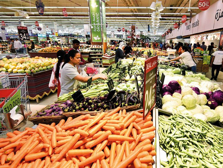 People shop at Carrefour Hypermarket in City Centre Mirdif