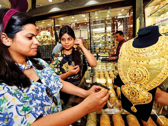 Shoppers check out a bridal jewellery set weighing 630.92 grams