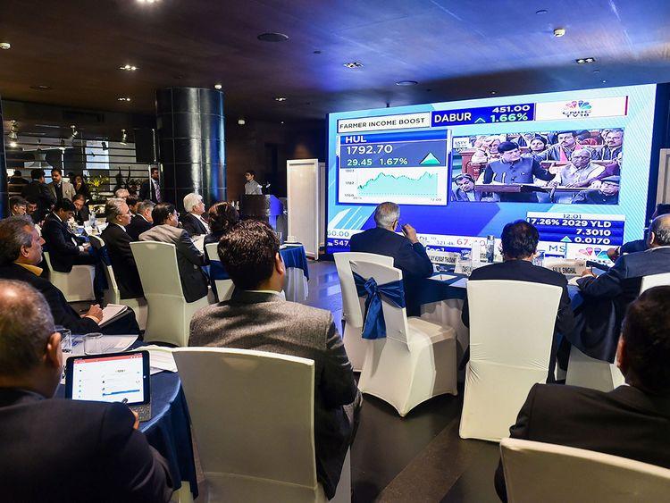 Business leaders watch the live telecast of the interim Budget presentatio