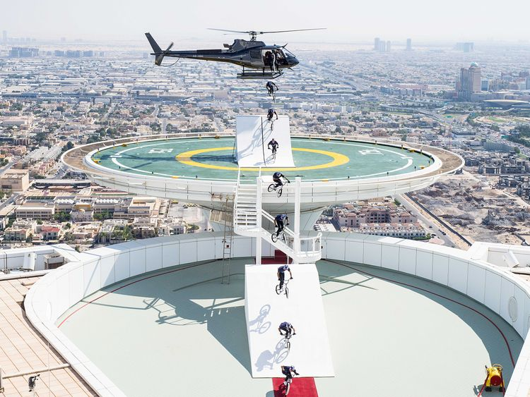 5e75793b A sequence showing Kriss Kyle jumping off a helicopter on the helipad of  the Burj Al Arab. Image Credit: Fred Murray/Red Bull Content