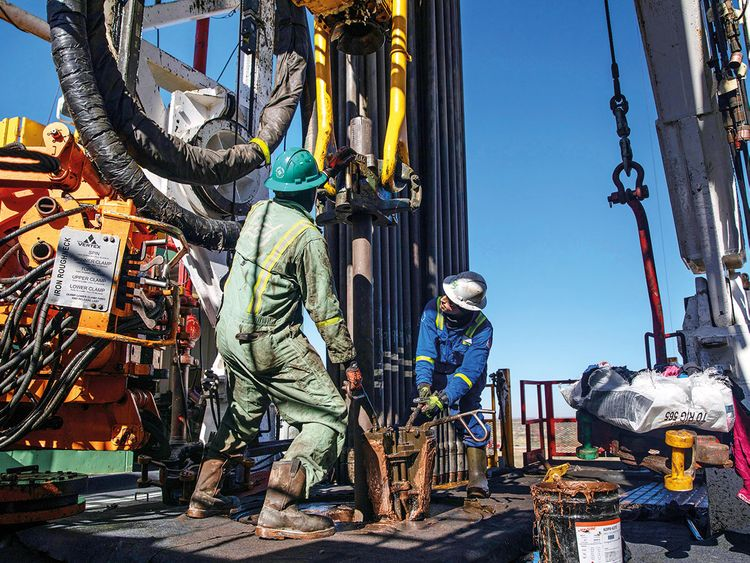 Drillers at a rig in the Delaware Basin near Wink, Texas