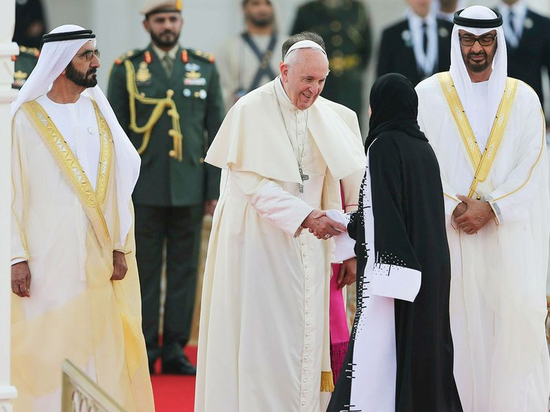 Pope Francis shakes hands with Amal Al Qubaisi