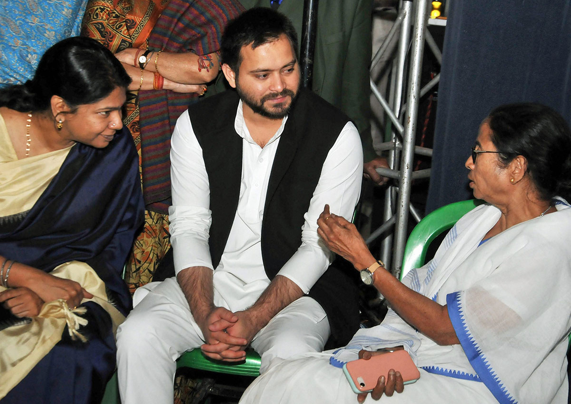 West Bengal Chief Minister Mamata Banerjee with DMK MP Kanimozh