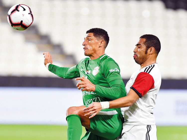 Action from the match between Al Jazira and Shabab Al Ahli