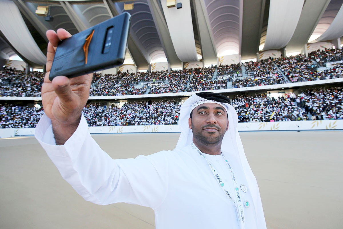 An Emirati official takes a selfie