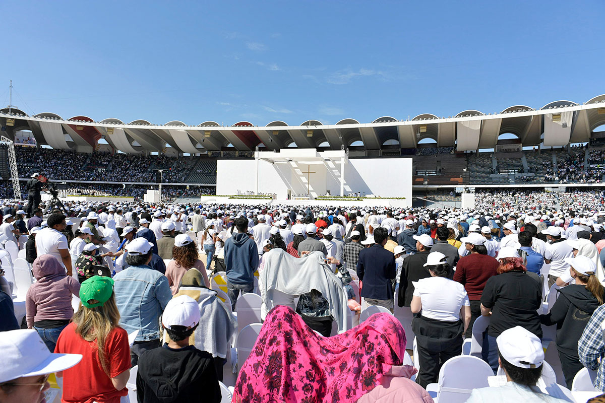 General view of Pope Francis holding 18
