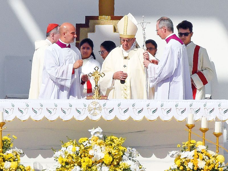 Pope Francis prepares to celebrate the mass