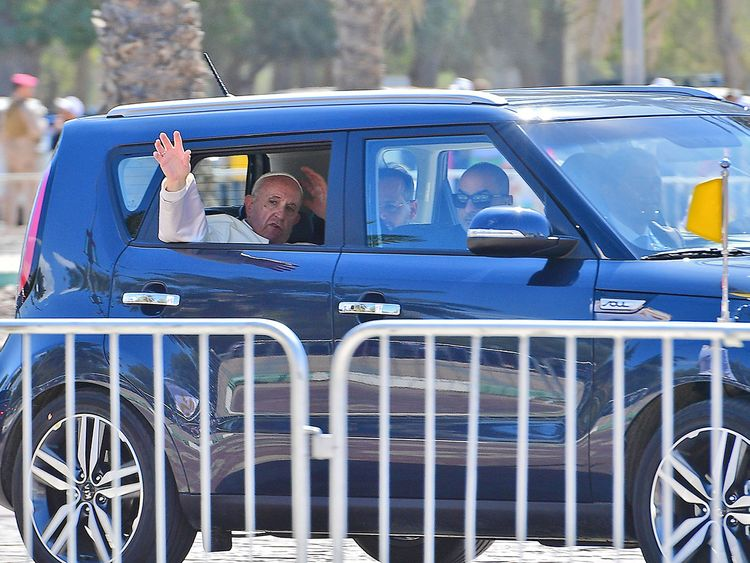 Pope Francis waves to the crowd following the mass