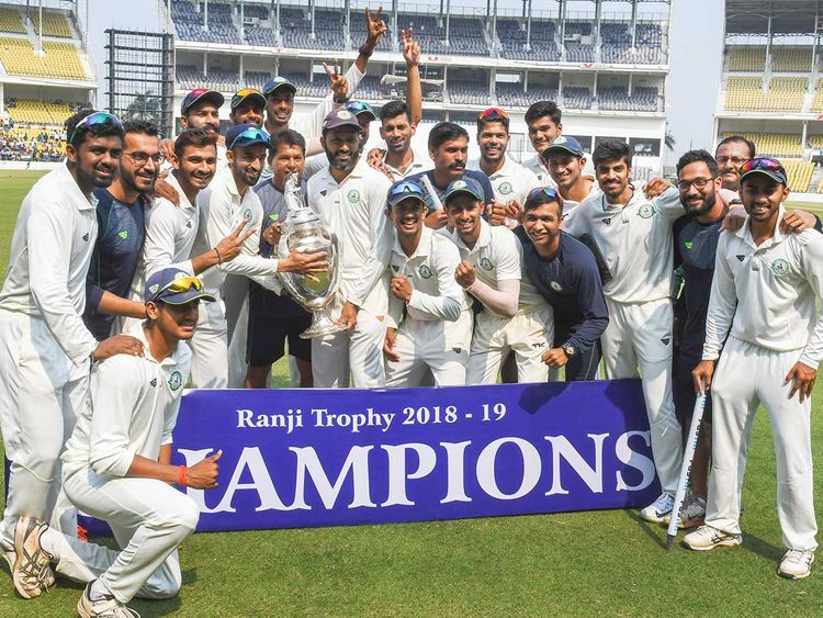 Vidarbha team poses with the trophy
