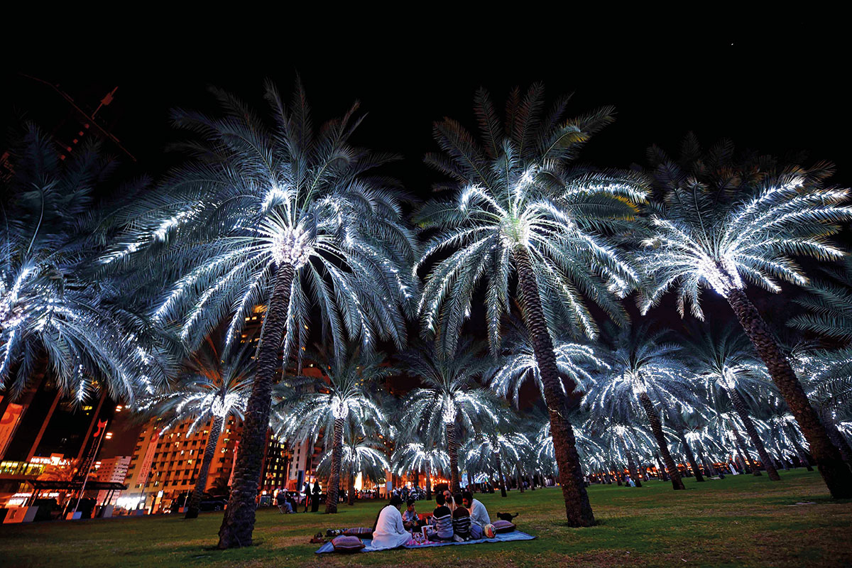 Families enjoy a night out at Buhairah Corniche Park