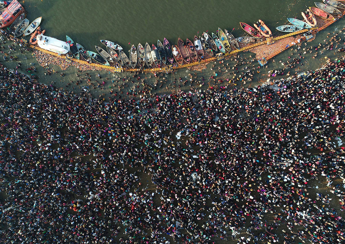 An aerial shot shows a sea of devotees