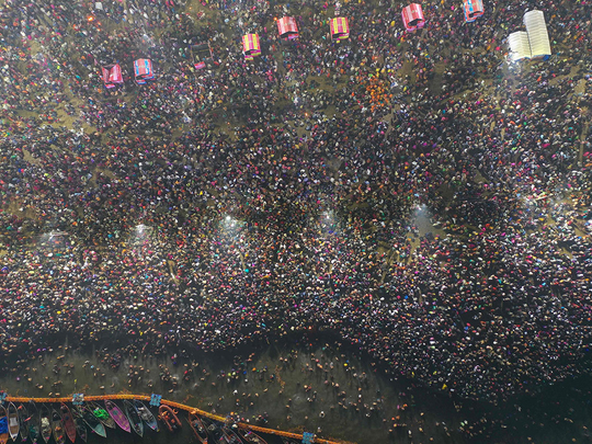 Devotees taking a holy dip at the Sangam
