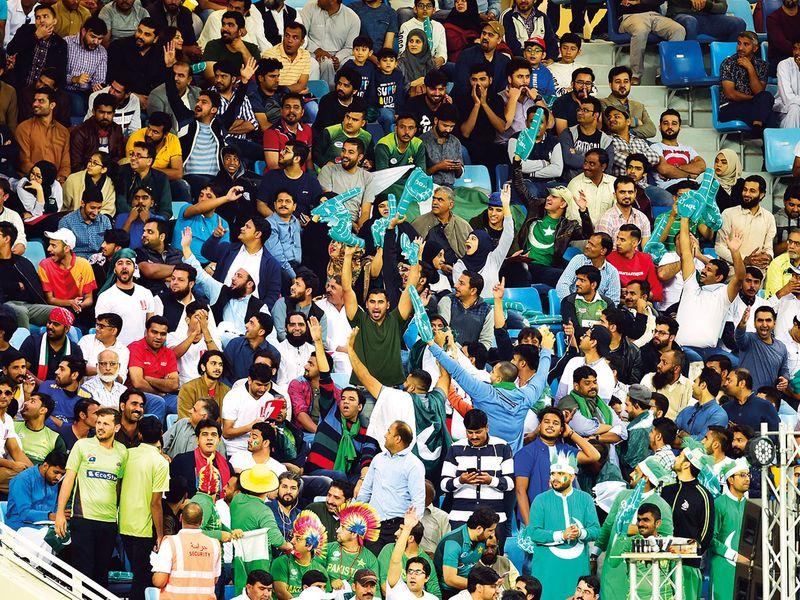 Cricket fans at the Sharjah Cricket Stadium
