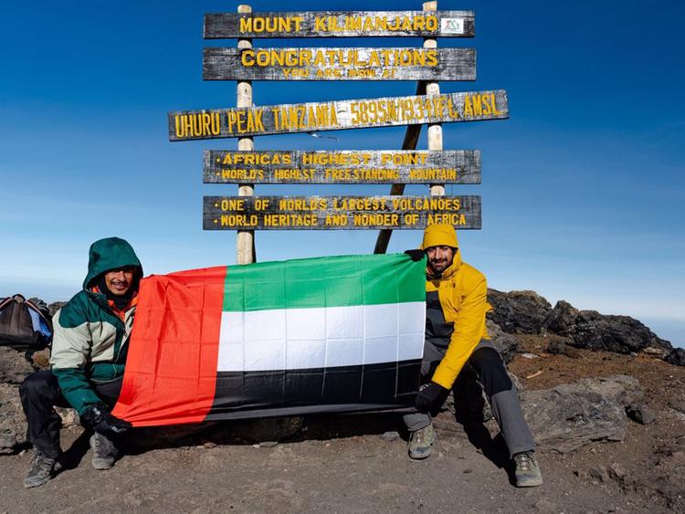 Saud-Al-Qasimi,-Omar-Al-Jahdami,-Mohammed-Al-Shehhi-Raise-UAE-Flag-atop-Mount-Kilimanjaro-1550156622438