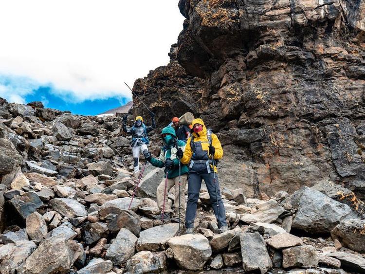 Saud-Al-Qasimi,-Omar-Al-Jahdami,-Mohammed-Al-Shehhi-Raise-UAE-Flag-atop-Mount-Kilimanjaro2-1550156629234