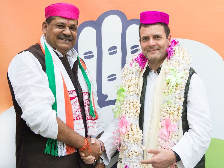 Congress President Rahul Gandhi with inducts cricketer-turned politician Kirti Azad
