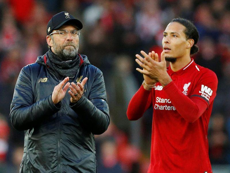 Liverpool manager Juergen Klopp and Liverpool's Virgil van Dijk