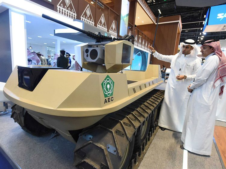 The visitors look at 'UGV' unmanned vehicle