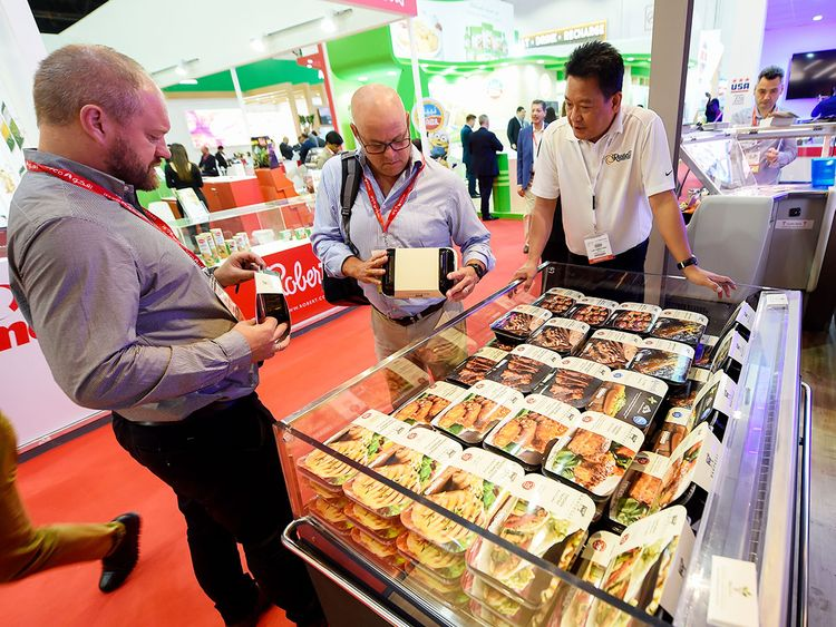 Visitors check out meat products from Rastelli group