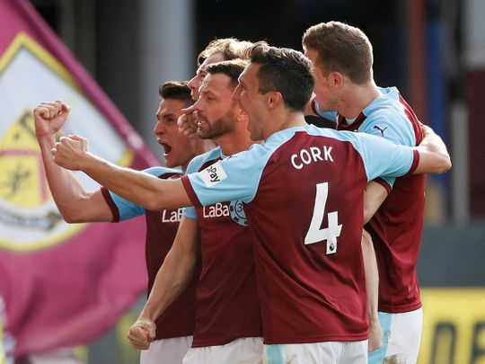 Burnley players celebrate a goal