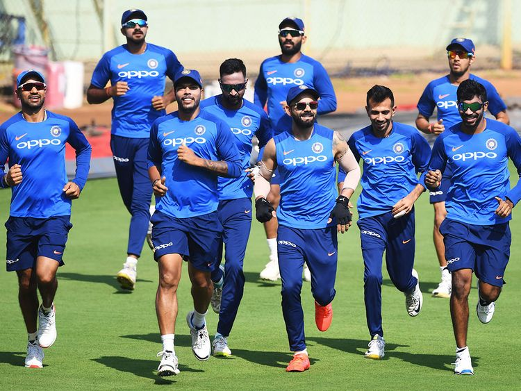 Indian cricket team's captain Virat Kohli (C) with teammates