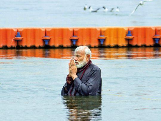 Prime Minister Narendra Modi takes a holy dip at Sangam