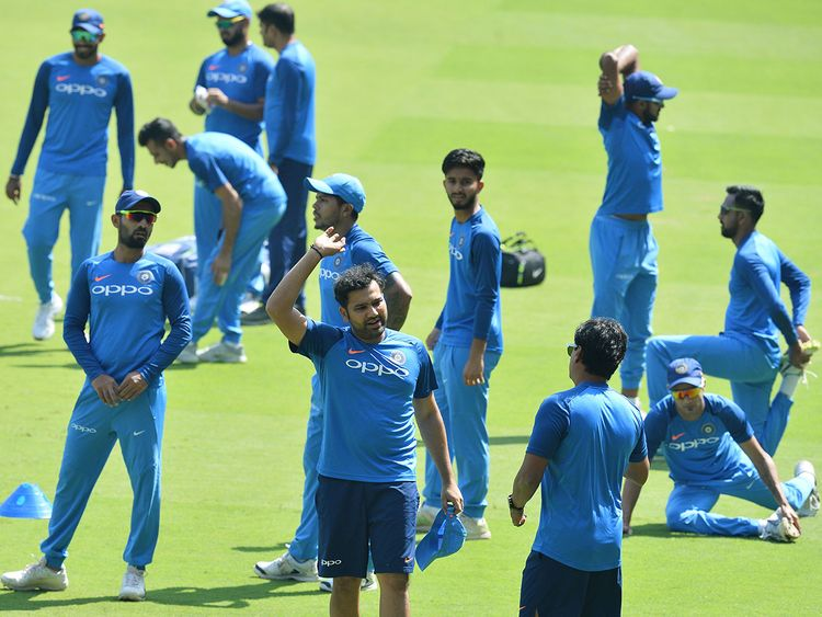 Indian cricketers take part in a practice session