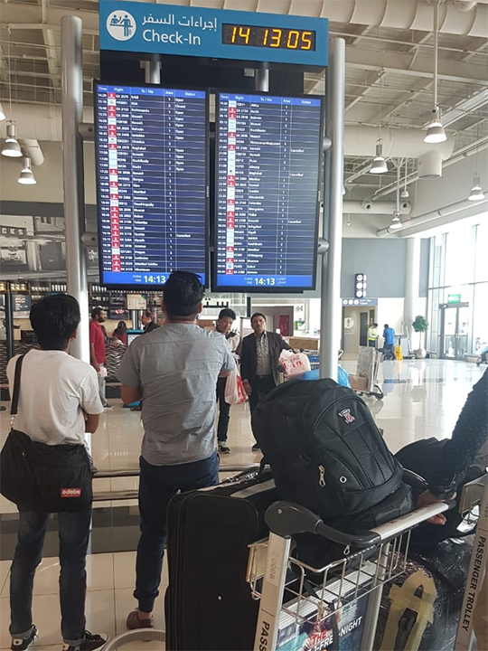 Passengers check out the cancelled flights