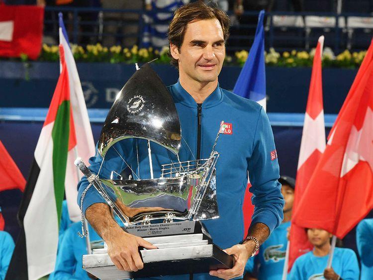 Roger Federer holds his trophy