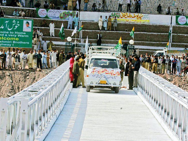 A vehicle crosses the bridge