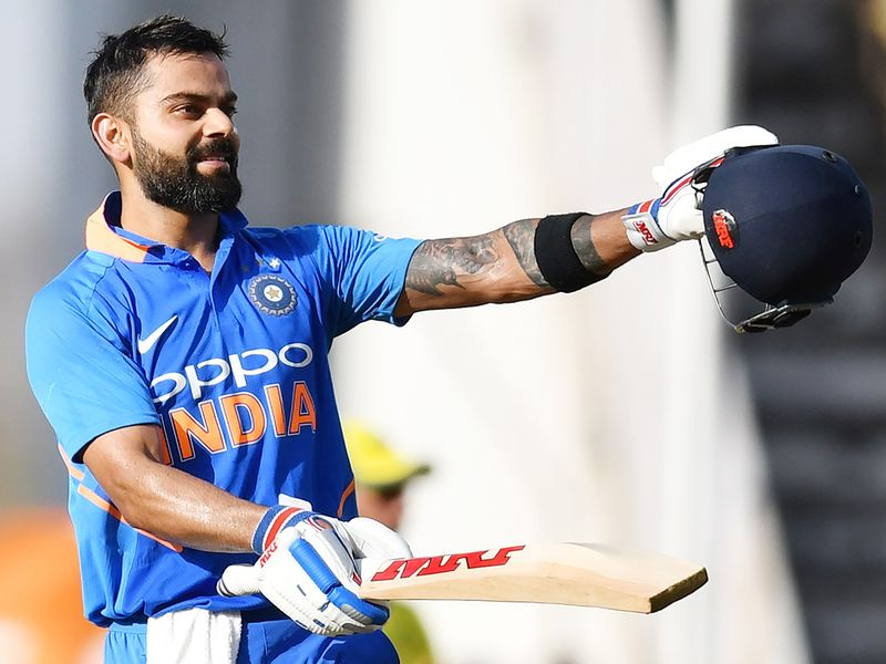 Indian captain Virat Kohli celebrates after scoring a century