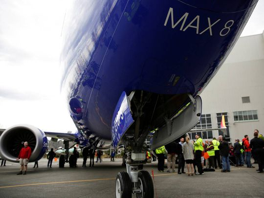Boeing employees are pictured in front of a 737 MAX 8 20190311