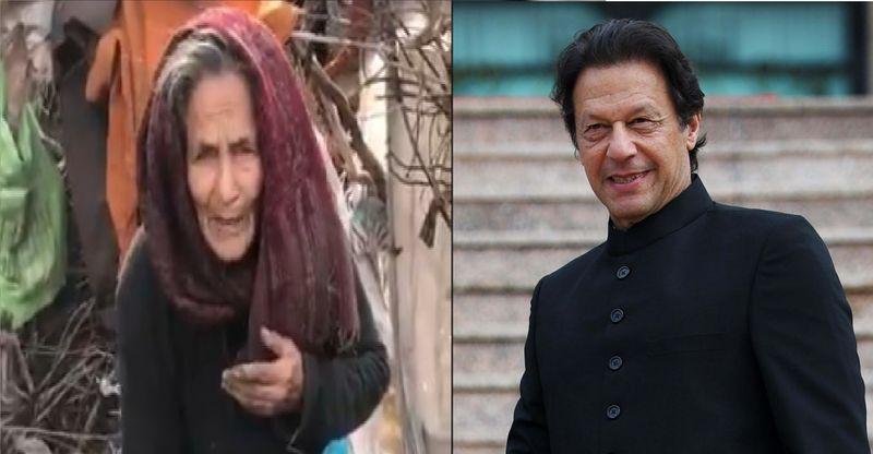 Khan helps elderly woman