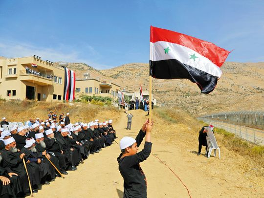 Druze people take part in a rally in Majdal Shams