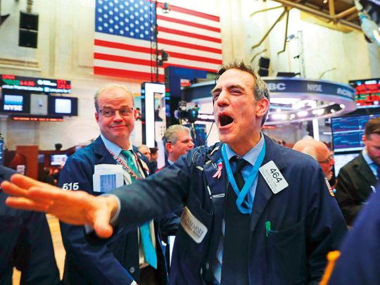 Traders at the New York Stock Exchange 7