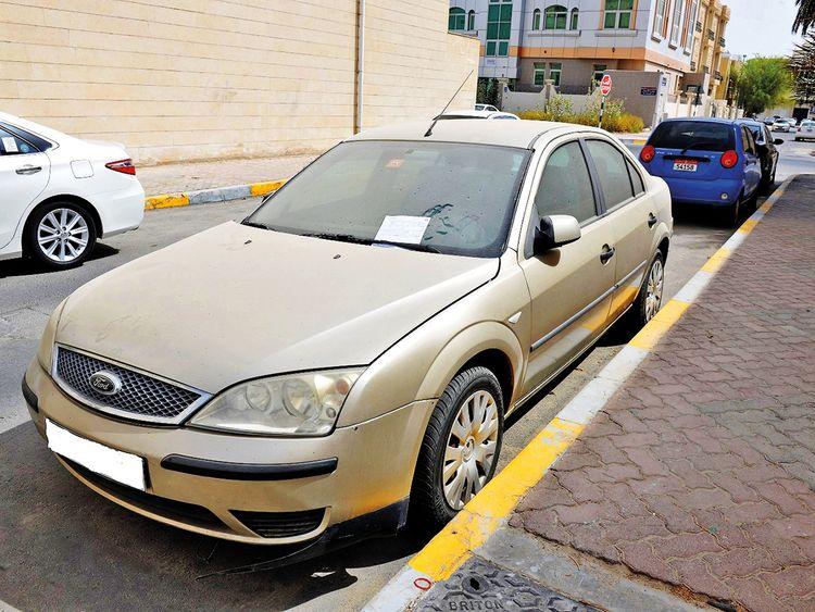 A dusty vehicle on an Abu Dhabi street