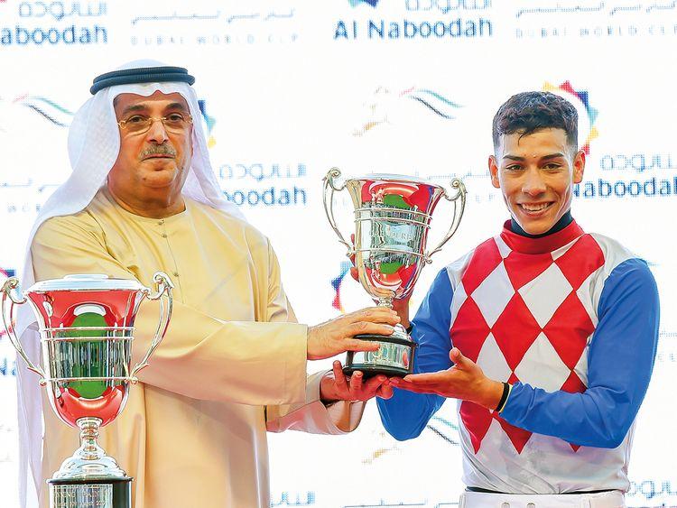 Jockey Jose Ortiz receives his trophy