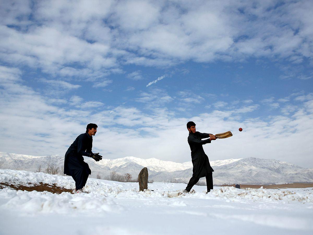 Afghan men play cricket