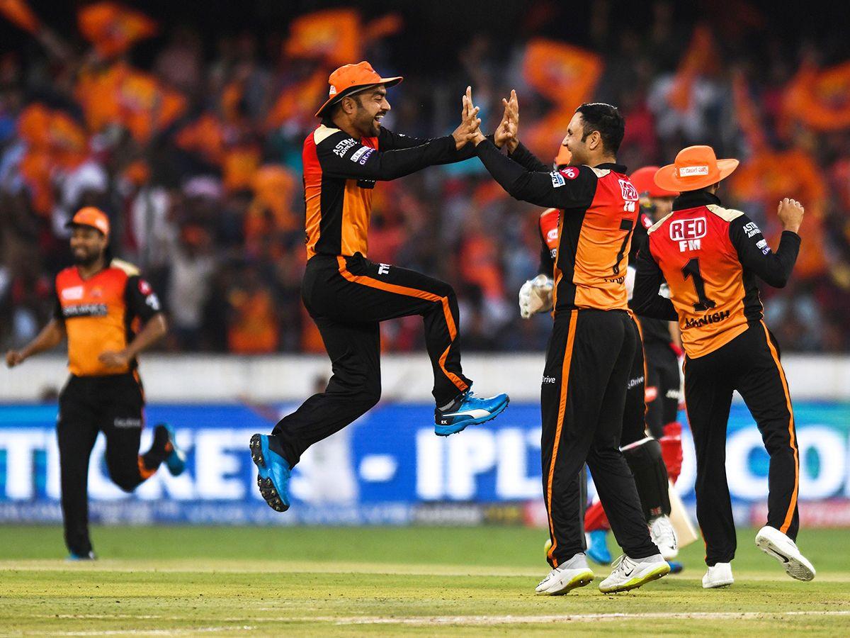 Sunrisers Hyderabad's Afghan players Mohammad Nabi (C) and Rashid Khan