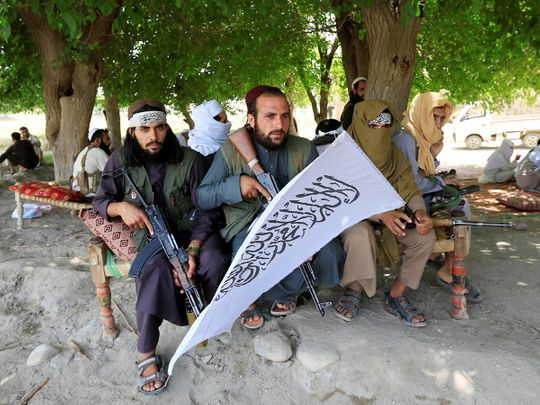 Taliban men gather to celebrate ceasefire