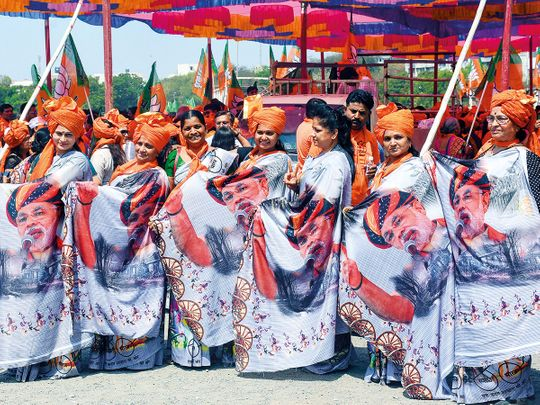 BJP supporters wear saris with PM Narendra Modi