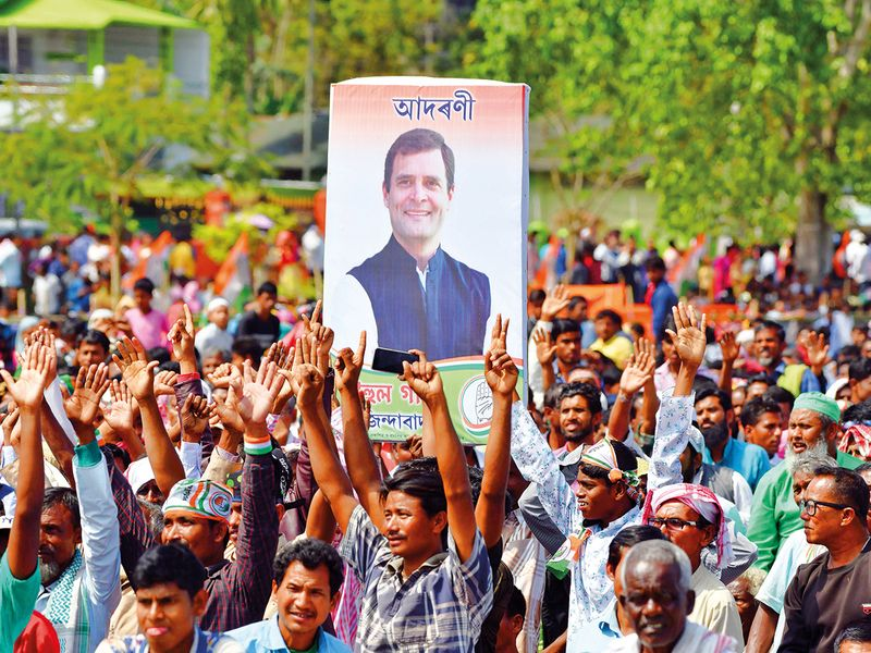 Congress supporters carry a poster of party president Rahul Gandhi