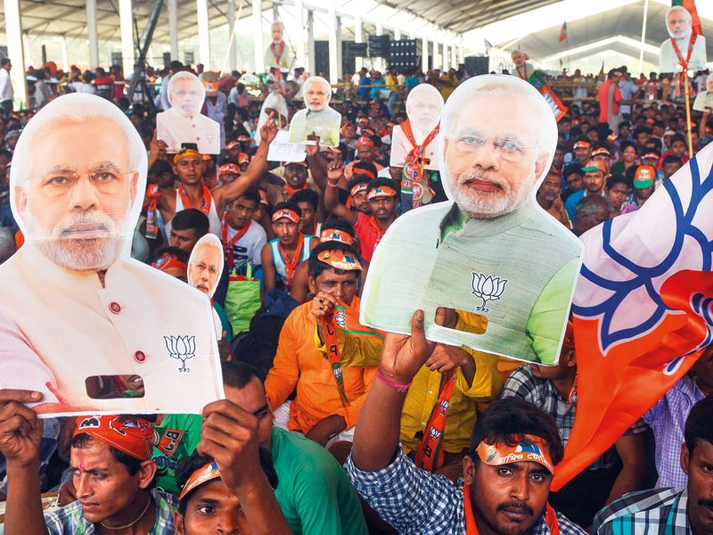 Supporters of the Bharatiya Janata Party (BJP) cheer