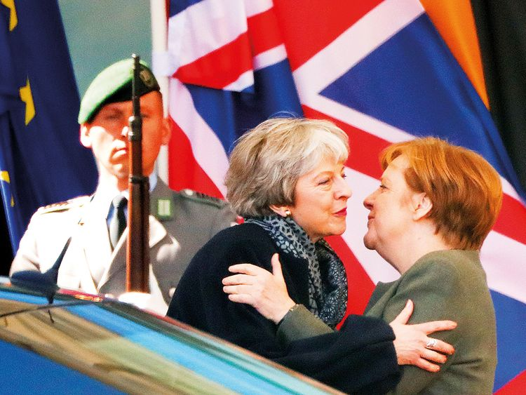 German Chancellor Angela Merkel kisses British Prime Minister Theresa May