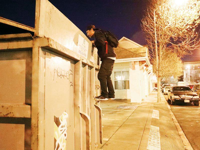 Jake Orta peers into a dumpster in San Francisco