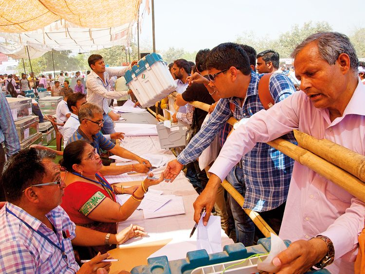 Polling officers collect election material in Ghaziabad