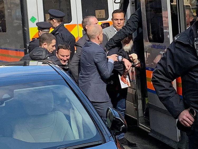Police bundle WikiLeaks founder Julian Assange